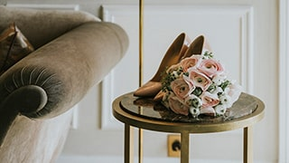 sina-demiral-sony-alpha-99II-bridal-shoes-and-bouquet-on-table