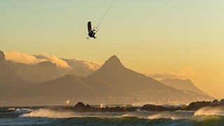 Danas-Macijauskas-sony-ILCE-6300-kitesurfer-silhouetted-against-mountain-backdrop