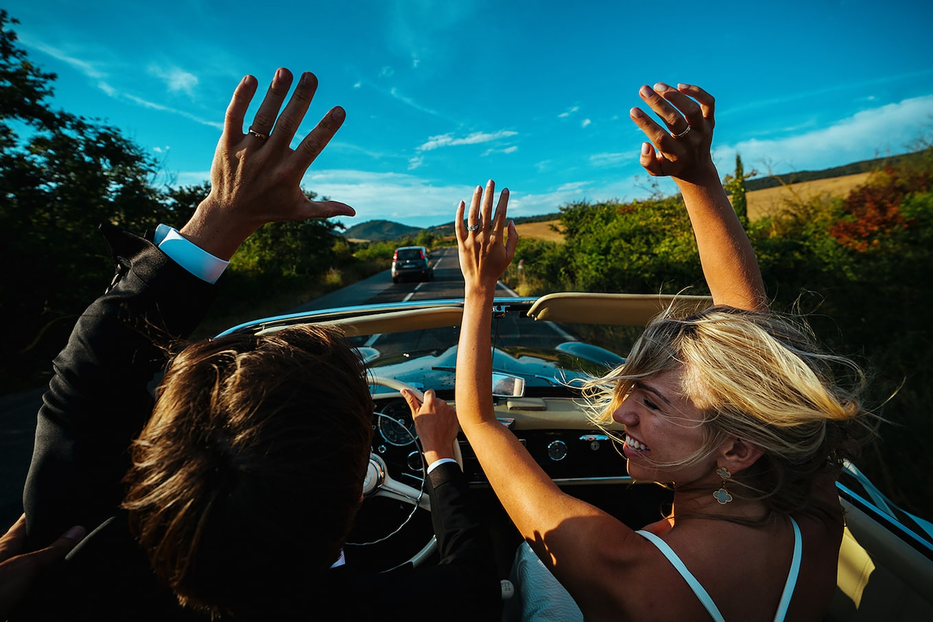 George-Kasionis-&-Stam-Tsopanakis-sony-alpha-7III-couple-waving-their-arms-in-the-air-like-they-just-dont-care
