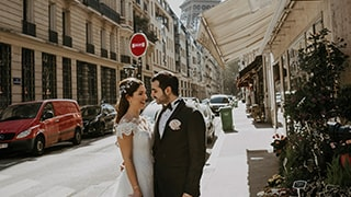 sina-demiral-sony-alpha-99II-bride-and-groom-standing-in-street-in-front-of-eiffel-tower-smiling